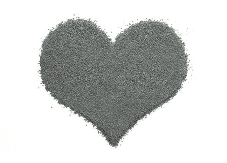instant coffee: Instant coffee granules in a heart shape, isolated on a white background - monochrome processing