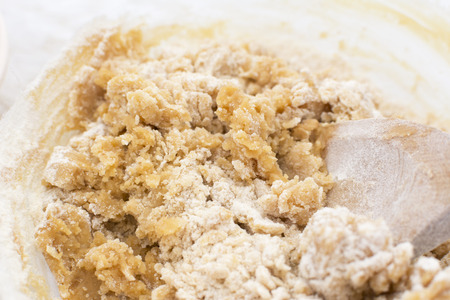 biscuit dough: Close-up of cookie dough being mixed with a wooden spoon