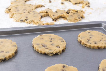 cookie sheet: Close-up of raw cookies on cookie sheet ready for the oven, dough scraps beyond