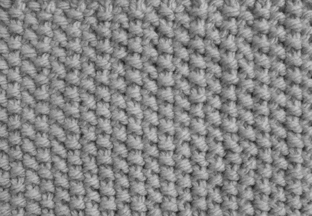Moss Stitch Knitting In Yarn As An Abstract Background Texture