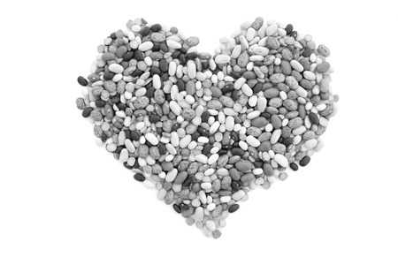 turtle bean: Mixed dried beans in a heart shape, isolated on a white background - monochrome processing