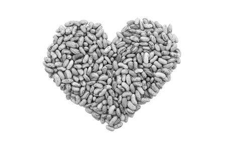 borlotti beans: Cranberry beans, or borlotti beans in a heart shape, isolated on a white background - monochrome processing