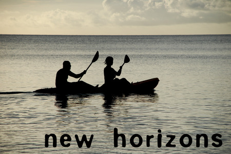 new horizons: Man and woman silhouetted at sea in a kayak, phrase NEW HORIZONS as concept text