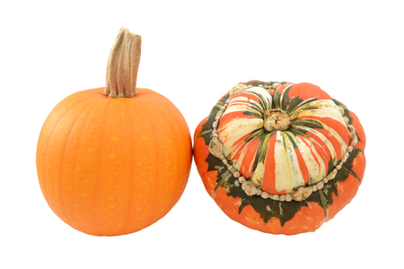 Small orange pumpkin and striped Turks Turban squash, isolated on a white background