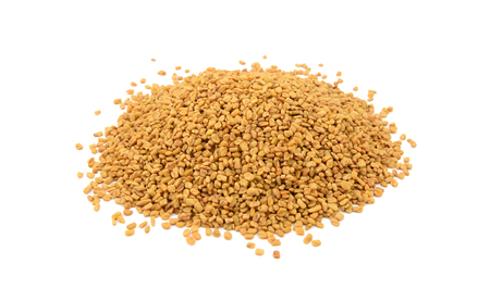 Dried fenugreek seeds, isolated on a white background Stock Photo