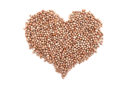 Dried pigeon peas in a heart shape, isolated on a white background