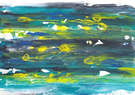 Abstract smears of paint in shades of blue with random yellow splashes