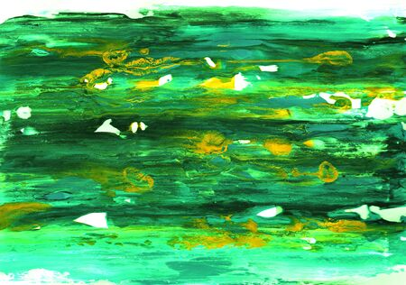 Shades of green acrylic paint smeared on white paper with yellow splashes