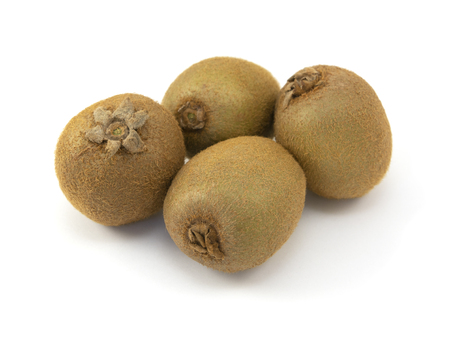 Four whole kiwi fruits with hairy skins on a white background
