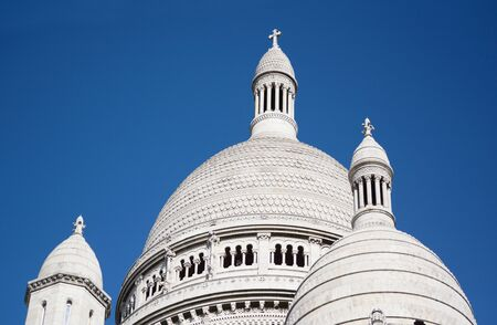 Dome rooftop of the Basilica of the Sacred Heart of Paris, ornate architecture in carved travertine limestone