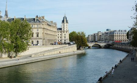 PARIS, FRANCE - SEPTEMBER 16, 2019: River Seine flows below the Pont Saint Michel in Paris on September 16, 2019. The corner tower of the Court of Cassation stands to the left of the bridge.