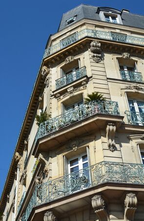 PARIS, FRANCE - SEPTEMBER 16, 2019: Ornate cast iron balconies on a building at the corner of Avenue de Wagram in Place des Ternes in Paris on September 16, 2019