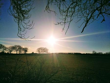 sunshine over field Stock Photo