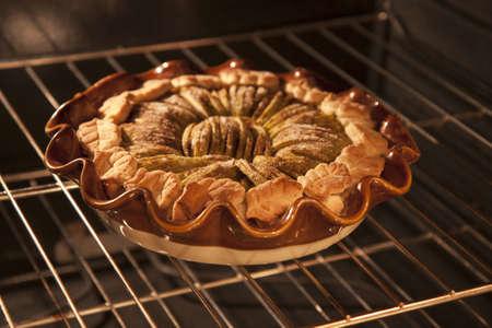 Apple tart baking in hot oven Reklamní fotografie