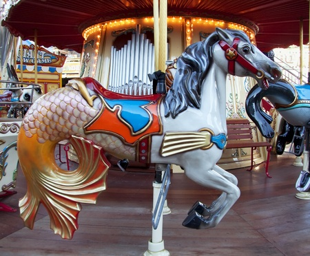 Carousel with colourful horse and lights waiting for kids