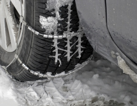 Close-up of car tire with icicles photo