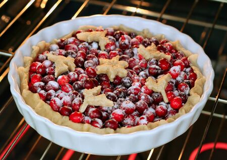 Cranberry tart in the hot oven