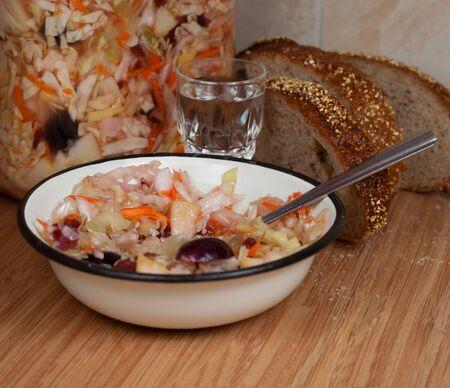 Sauerkraut cabbage, rye bread and shot glass of vodka