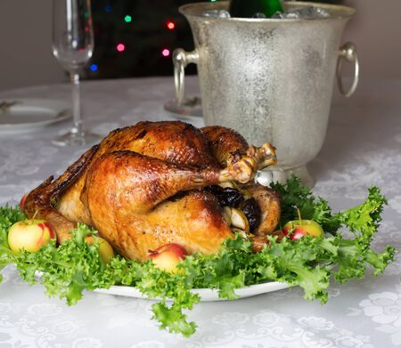 capon: Christmas or New Year  table with roast stuffed capon