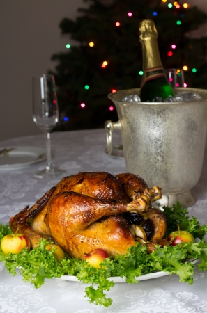 capon: Christmas (New Year) table with roast stuffed capon and bokeh in background Stock Photo