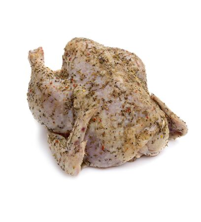 capon: Raw chicken with spices  brine  on white background Stock Photo
