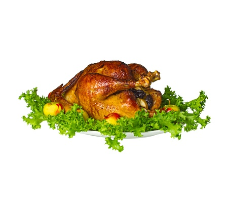capon: Plate with whole roast chicken on white background