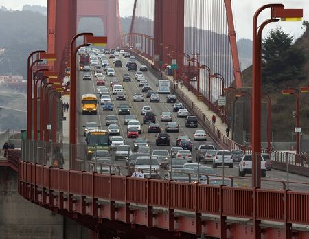 SAN FRANCISCO, CA USA – SEPTEMBER 10 - Golden Gate bridge with cars, trucks, buses, pedestrians and cyclists at 3 30 pm on September 10,2013