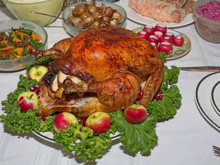 capon:  Holiday table with roast stuffed capon on decorated plate Stock Photo