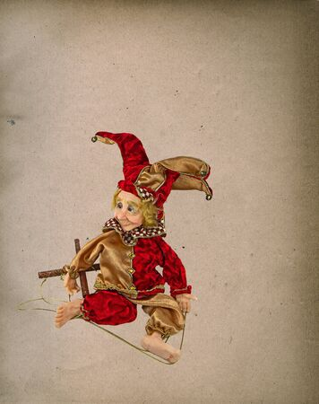 jester: Retro Jester puppet on old grunge paper texture background