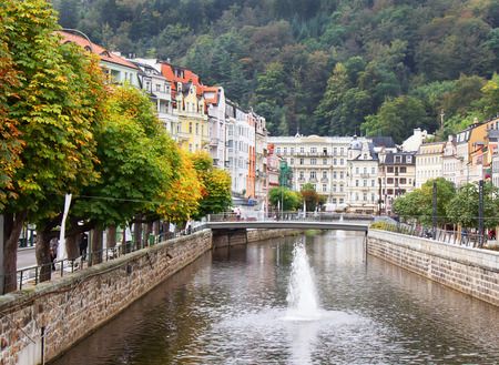karlovy vary: Tepla river,homes and autumn trees in Karlovy Vary (Karlsbad), Czech Republic.