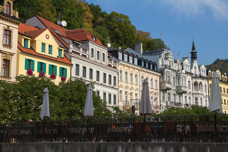 Street with historical buildings and bridge over the river Tepla in Karlovy Vary, Czech Republic.