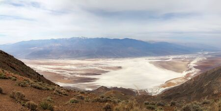 Panoramic view on Badwater salt flats from Black Mountains Dantes View. Death Valley, California Фото со стока