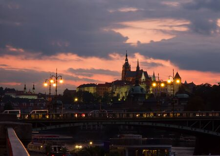 Sunset  in Prague with Vltava river, Chekhov Bridge and Prague Castle. Banco de Imagens - 78463636