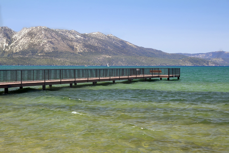 Lanscape with clear Lake Tahoe,pier and mountains.