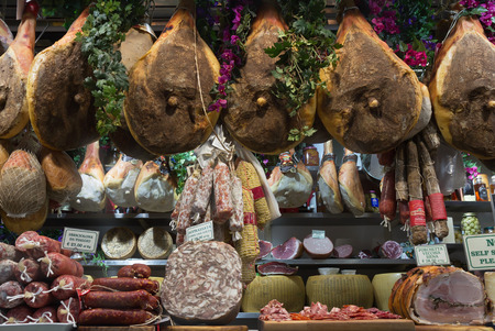 FlorenceItaly- April 6, 2018: Display with various italian gourmet meat products at famous Mercato Centrale or Mercato San Lorenzo market