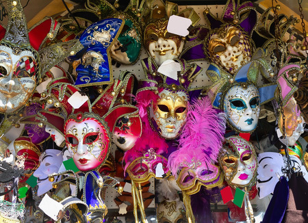 Display with colorful traditional venetian mask for sale in Venice.