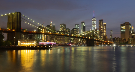 Evening view with Brooklyn Bridge and Manhattan skyline. New York City. Editorial
