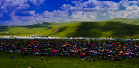 scorching: Tibetan people under the scorching sun in grassland
