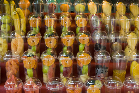 Individual fruit cups of various tropical fruits, sliced and ready for a sensational smoothie. Stock Photo