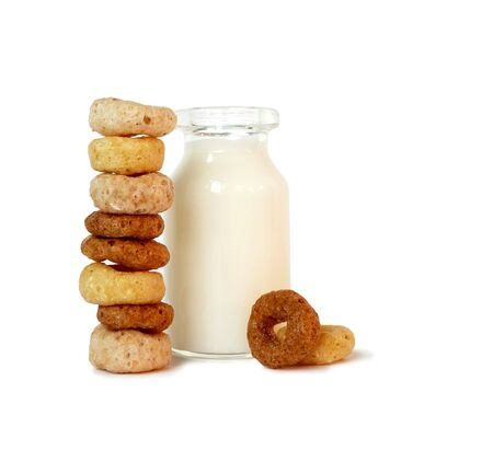 isolated balanced column of breakfast cereal and mini milk bottle Stock Photo - 3389142