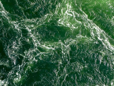 abstract background of light reflecting off the texture of rippling water and sea foam
