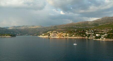 beautiful view of a sailboat sailing off the Dalmation Coast of Croatia