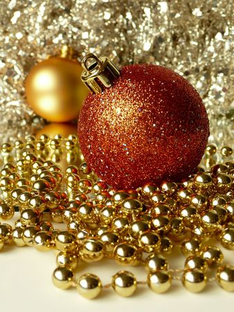 red & gold christmas tree balls surrounded by tinsel and decorative beads Stock Photo - 3574038