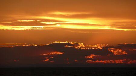 heavenly orange and yellow sunset over ocean Stock Photo - 3587650