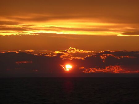 beautiful red and orange sunset with golden cloud linings