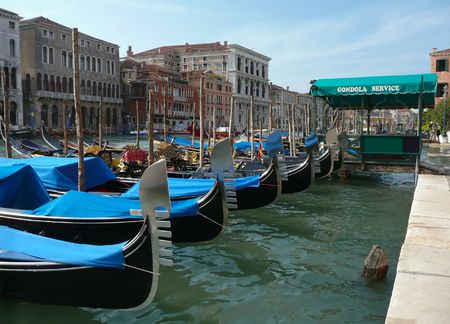 Decorative gondolas lined up in the canal ready for tourists in Venice.