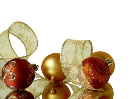 corner background decorations of red and gold Christmas tree balls and ribbons isolated on white photo