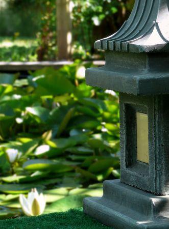 Japanese stone lantern with lotus pond water garden