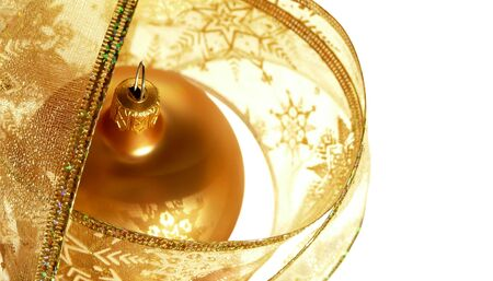 Gold Christmas ornament in  ribbon on white background Stock Photo
