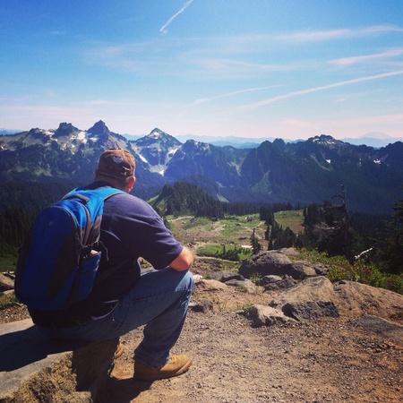 Hiker resting at mt. Rainier national park Washington  Stock Photo